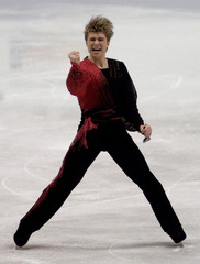 RUSSIAN SKATER YAGUDIN CLEBRATES HIS SHORT PROGRAM AT WORLD CHAMPIONSHIPS.