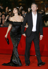 """Italian actress Bellucci poses on the red carpet with her husband French Vincent Cassel at the premiere of her latest movie """"L'Uomo che ama"""" at Rome's Film Festival"""