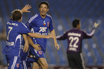 Universidad de Chile's Olivera celebrates with teammates after scoring against Fluminense during their Copa Sudamericana soccer match in Rio de Janeiro