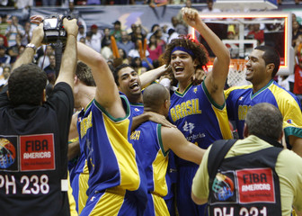 Varejao of Brazil celebrates with teammates after defeating Puerto Rico in men's FIBA Americas Championship gold medal final basketball game in San Juan