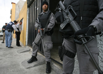Federal policemen stand guard during an anti-narcotics operation in Mexico City