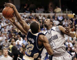 Antonio Graves of Pittsburgh slaps the ball from the hand of DaJuan Summers of Georgetown during their NCAA basketball game in Washington