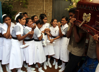 Sri Lankan nurses grieve the death of a colleague in a recent blast in Trincomalee