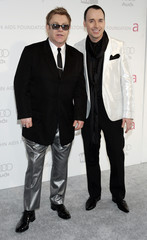 Elton John and David Furnish pose at the 2007 Elton John AIDS Foundation Oscar Party in West Hollywood