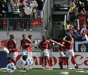 Toronto FC players celebrate their first goal of the season scored by Dichio against the Chicago Fire during their match in Toronto