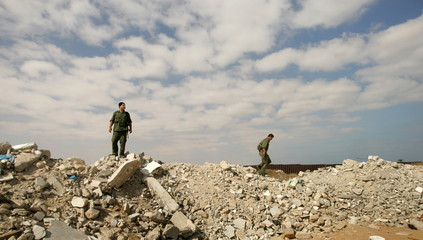 Palestinian security forces patrol near the Rafah border (in background) between Egypt and the south..