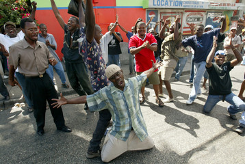 HAITIANS WELCOME REBELS IN PORT AU PRINCE.