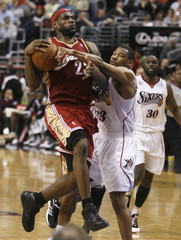 Cavaliers forward James is fouled by the Philadelphia 76ers guard Green during NBA basketball action in Philadelphia