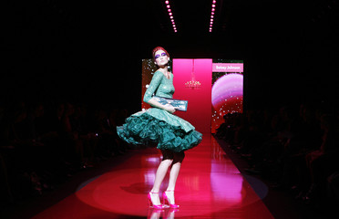 A model presents a creation by designer Betsey Johnson during a fashion show celebrating Barbie's 50th anniversary during New York Fashion Week in New York