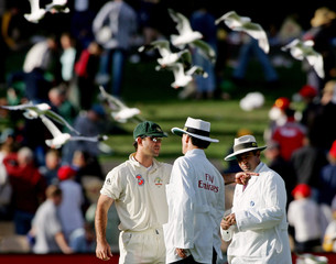 Australia's captain Ponting talks with umpires Bowden and Dar after a heated discussion with Powell from West Indies during the third day of the third cricket test in Adelaide