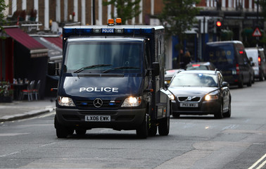 A police convoy arrives at Westminster Magistrates Court where Khalid Mohamed Omar Ali, who was arrested near Parliament Square three weeks ago is due to appear on charges of preparing terrorist acts, in London