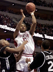 OKLAHOMA CENTER MCGHEE PUTS UP SHOT AGAINST XAVIER IN FIRST HALF OFROUND TWO IN WEST REGIONAL.