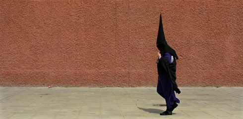 A penitent on his way to procession of San Bernardo brotherhood during Holy Week in Seville.