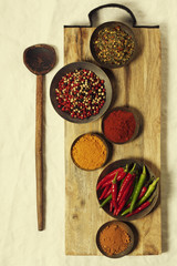 Fototapete - Different spices in bowls on table