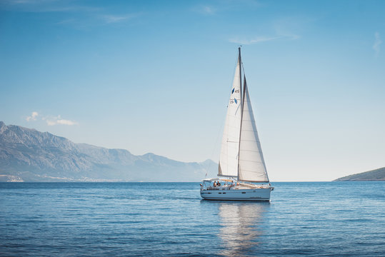 Sailing yacht in the sea against the backdrop of mountains