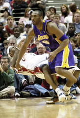 Cavaliers James is hit in the face by Lakers Bryant.