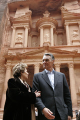 Portuguese President Anibal Cavaco Silva poses with his wife Maria in front of the treasury site during their visit to the ancient Jordanian ruins of Petra