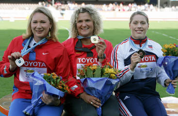 Winners pose after women's discus throw medal ceremony at world athletics championships, Helsinki.
