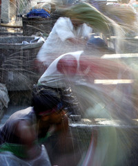 Indian laundryman wash clothes in 'dhobi ghats' in Bombay.