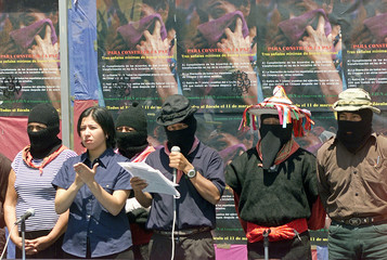 ZAPATISTA COMMANDER READS STATEMENT IN MEXICO CITY.