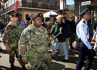 NATIONAL GUARD PATROL FRENCH QUARTER IN NEW ORLEANS BEFORE SUPER BOWL.