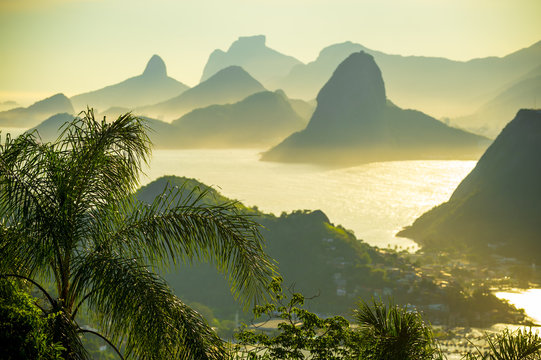 Golden sunset scenic view of the dramatic landscape setting of Rio de Janeiro, Brazil with Guanabara Bay