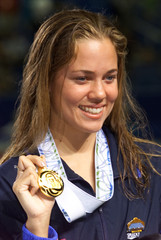US COUGHLIN WINS GOLD MEDAL IN WOMEN'S 100M BACKSTROKE IN WORLDSWIMMING CHAMPIONSHIPS IN FUKUOKA.