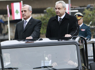 Lebanese President Sleiman reviews army troops with Defence Minister al-Murr during independence day parade in downtown Beirut