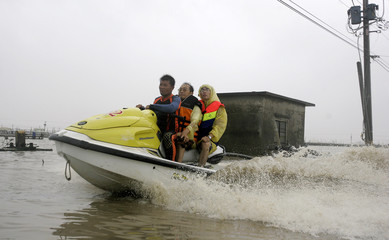 A rescue worker uses jet ski to evacuate residents from floods caused by Typhoon Morakot in Pingtung county, southern Taiwan