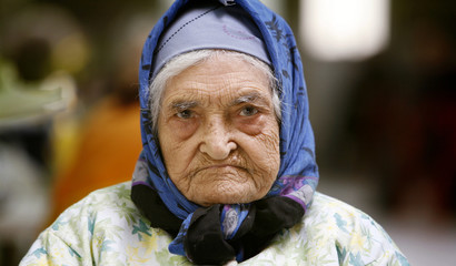 Iranian Jew looks on while sitting corridor of Yahoodi nursing home in Tehran