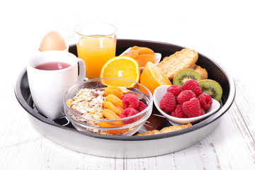 breakfast with oatmeal, orange juice and fruits