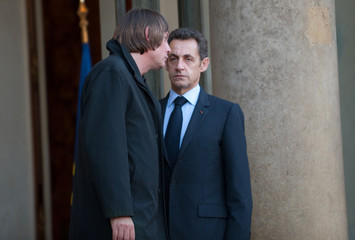France's President Sarkozy speaks with CGT union leader Thibault at the ELysee Palace in Paris