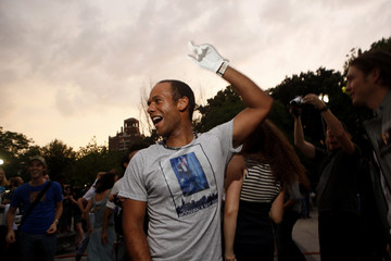 A fan dances to celebrate the life of pop icon Michael Jackson at Washington Square Park in New York