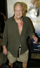 File photo of comedian Rodney Dangerfield arriving at premiere.