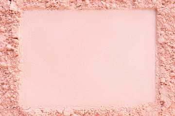 Extruded horizontal frame in a foundation cosmetic powder