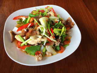 Spicy mix seafood and vegetable in white plate