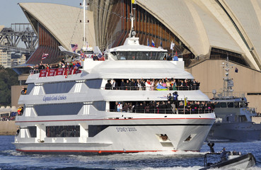 Boat carrying Pope Benedict XVI is escorted by police boats in front of the Sydney Opera House during a Harbour cruise