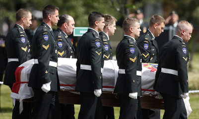 The casket of corporal Christian Bobbitt is carried into the church before his funeral at the Valcartier Garison in Shannon