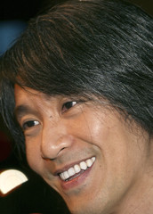 """Hong Kong actor-director Stephen Chow smiles during the premiere of """"Kung Fu Hustle"""" in Hollywood."""