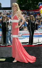 "Actress Lindsay Lohan poses for the photographers at the world premiere of Disney Pictures' ""Herbie - ..."
