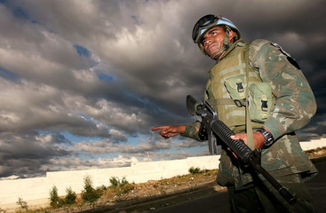 A Brazilian UN peacekeeper stands guard at checkpoint in Port-au-Prince