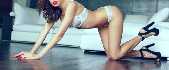 Sexy woman with red lips and nails posing on floor banner