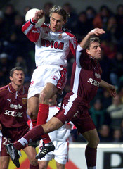 GAILLOT OF METZ AND PRSO OF MONACO JUMP FOR THE BALL.