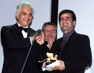 The president of Venice film festival Paolo Barale (L) with the President of Jury Milos Forman (C) p..