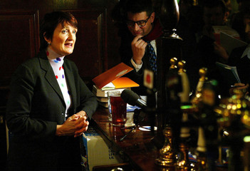 Britain's Culture Secretary Tessa Jowell stands behind pumps at a London pub at the launch of the go..