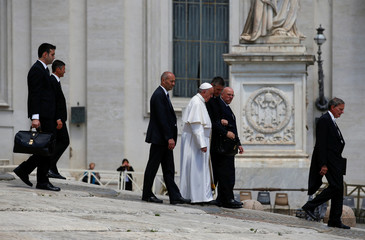 Pope Francis leaves at the end of the Wednesday general audience in Saint Peter's square at the Vatican