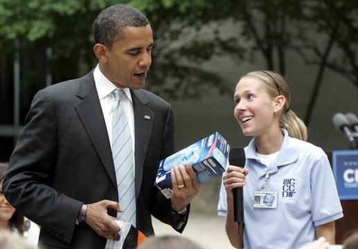 Presumptive U.S. Democratic presidential candidate Barack Obama is presented with a dental hygiene kit by Dental hygienest student Holly Siemens in Taylor