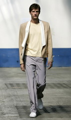 A model for Singapore-born designer Jonathan Seow for Woods & Woods fashion house presents a creatio..