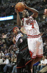 Bulls' Gordon shoots as 76ers' Iverson looks during second half of their NBA game in Chicago