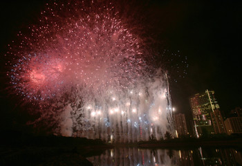 Fireworks explode in front of Crown Macau during its opening ceremony in Macau